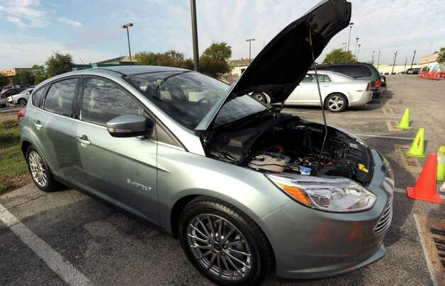 A Ford Focus Electric was on display, along with other Ford environmentally friendly vehicles, at the UTSA downtown campus on Tuesday, Oct. 11, 2011. The model will soon will be available to the public. Photo: BILLY CALZADA, Billy Calzada/gcalzada@express-news.net / gcalzada@express-news.net