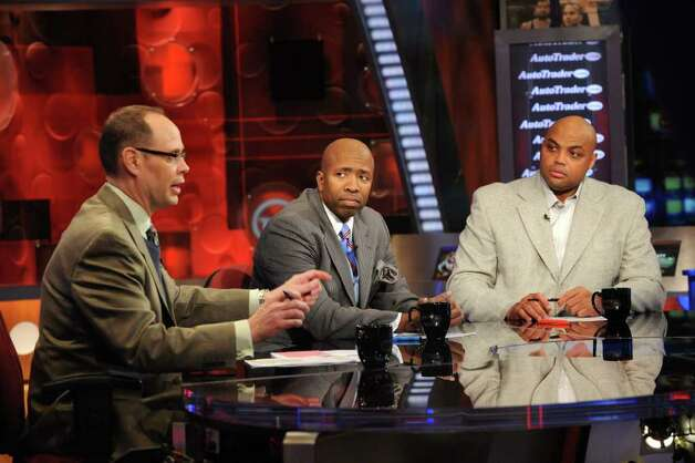 In this photo taken on Thursday, Feb. 4, 2010,  Inside the NBA host Ernie Johnson Jr., left,  and analysts Kenny Smith, center, and Charles Barkley are shwon on the set at the TNT studios in Atlanta. Photo: Erik S. Lesser, AP / FR53108 AP