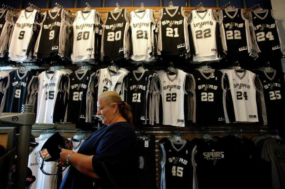 Travelers will be able to stock up on Silver & Black gear once the newest Spurs Fan Shop opens inside the San Antonio International Airport on Friday. The store is the third location in San Antonio, joining one at the AT&T Center and another at The Shops at La Cantera. Travelers can find the shop near the Aeroméxico and Interjet gates in Terminal A. Photo: Kin Man Hui/kmhui@express-news.net / kmhui@express-news.net