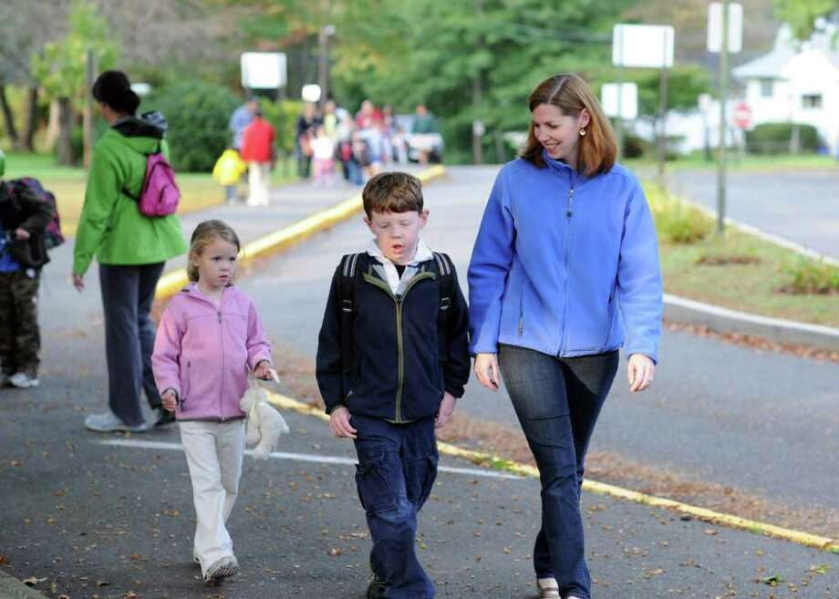 The Sullivans bundled up in fall jackets for the early morning stroll to Holland Hill Elementary School on Naitonal Walk to School Day. Photo: Contributed Photo / Fairfield Citizen contributed
