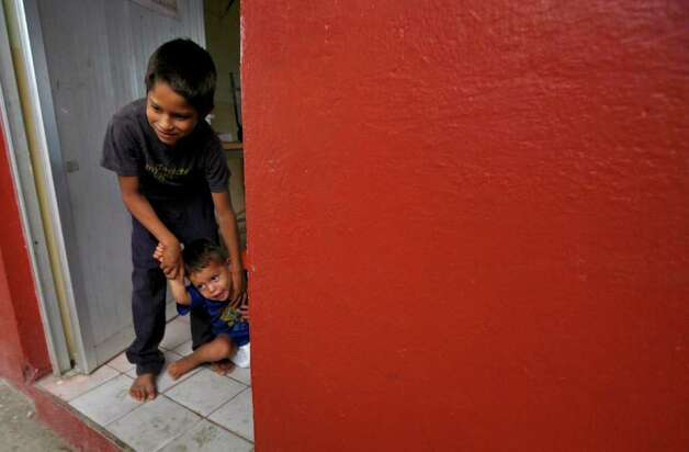 Two children play in a doorway of a classroom where their family is taking shelter in Jaluco, Mexico, Tuesday Oct. 11, 2011. Jova weakened a little as it neared land, but it still had maximum sustained winds of 100 mph, the U.S. National Hurricane Center reported, forecast to make landfall between Barra de Navidad and Puerto Vallarta late Tuesday. Some residents began taking refuge at storm shelters in towns like Jaluco, just inland from the beach community of Barra de Navidad. Photo: AP