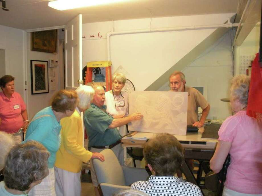 Artist Donald Axleroad discusses making a print with Staying Put members, following a demonstration by his assistant Charlie Wiesehahn, right. Photo: Contributed Photo