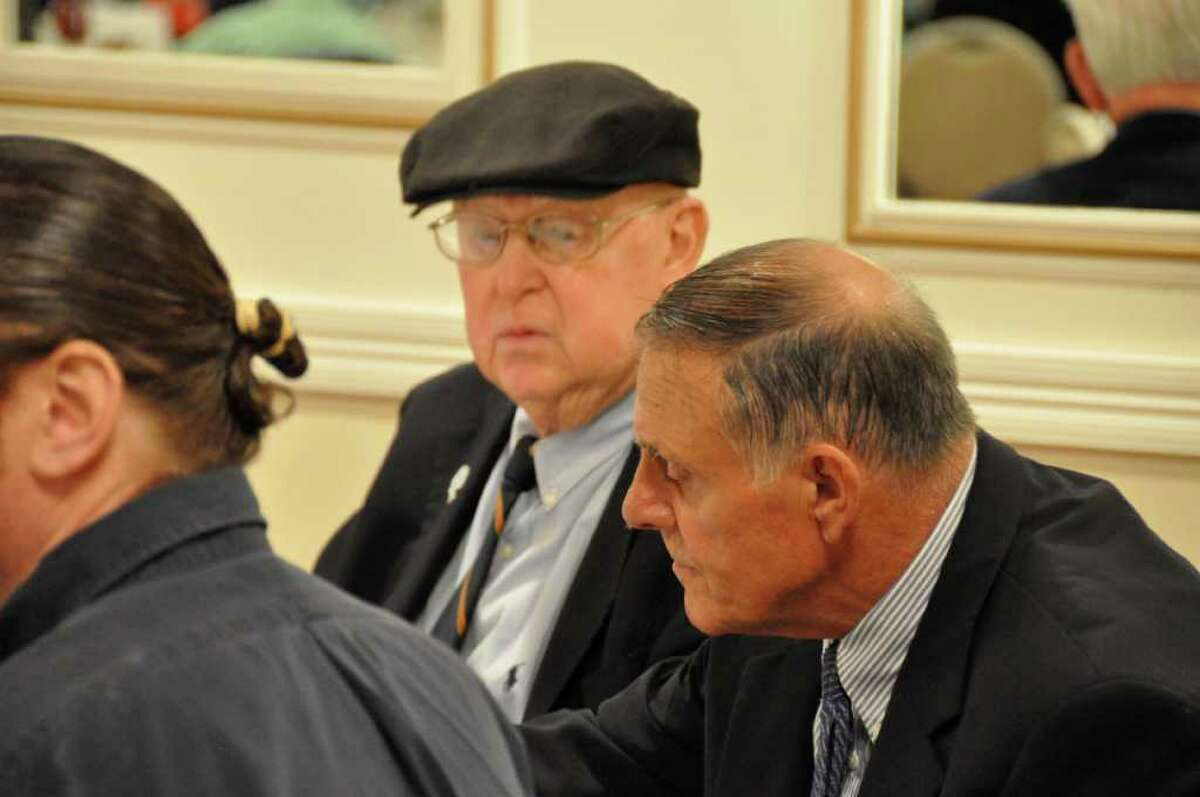 Jerry McDougall (left, with a hat) sits with Richard Whitcomb at his last public appearance at the Ralph DeSantis Fairfield County Chapter of the National Football Foundation & College Hall of Fame scholar-athlete banquet on April 26, 2011. A legendary coach, McDougall died Oct. 11 at 75.