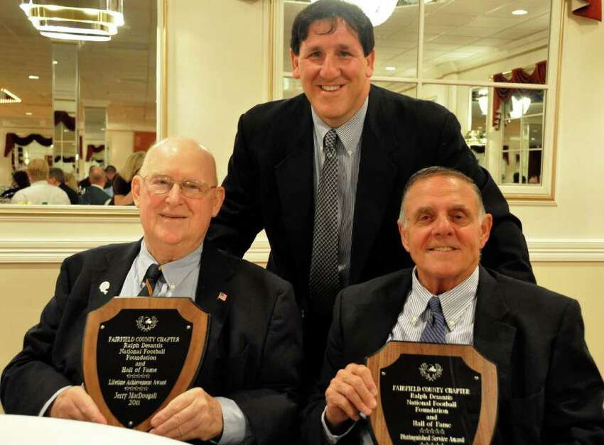 Jerry McDougall (left) poses with John Barbarotta (center) and Richard Whitcomb (right) at his last public appearance at the Ralph DeSantis Fairfield County Chapter of the National Football Foundation & College Hall of Fame scholar-athlete banquet on April 26, 2011. A legendary coach, McDougall died Oct. 11 at 75.