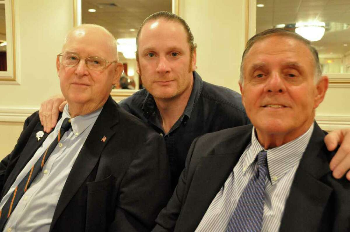Jerry McDougall (left) poses with his son Jerry McDougall Jr. (center) and Richard Whitcomb (right) at his last public appearance at the Ralph DeSantis Fairfield County Chapter of the National Football Foundation & College Hall of Fame scholar-athlete banquet on April 26, 2011. A legendary coach, McDougall died Oct. 11 at 75.