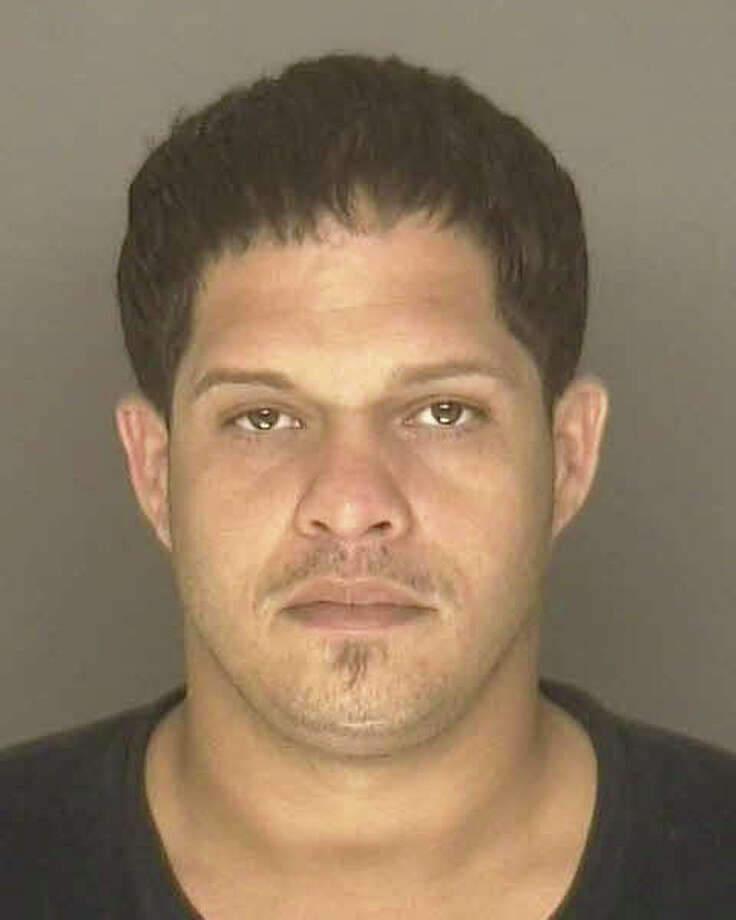 Julio Morales-Rivera, 36, was served with a Florida warrant charging him with first-degree murder, conspiracy to commit murder and being a fugitive from justice and was being held in lieu of $1 million bond. He was arrested in Bridgeport on Oct. 12, 2011 by members of the U.S. Marshal Violent Crime Fugitive Task Force. Photo: Contributed Photo / Connecticut Post Contributed