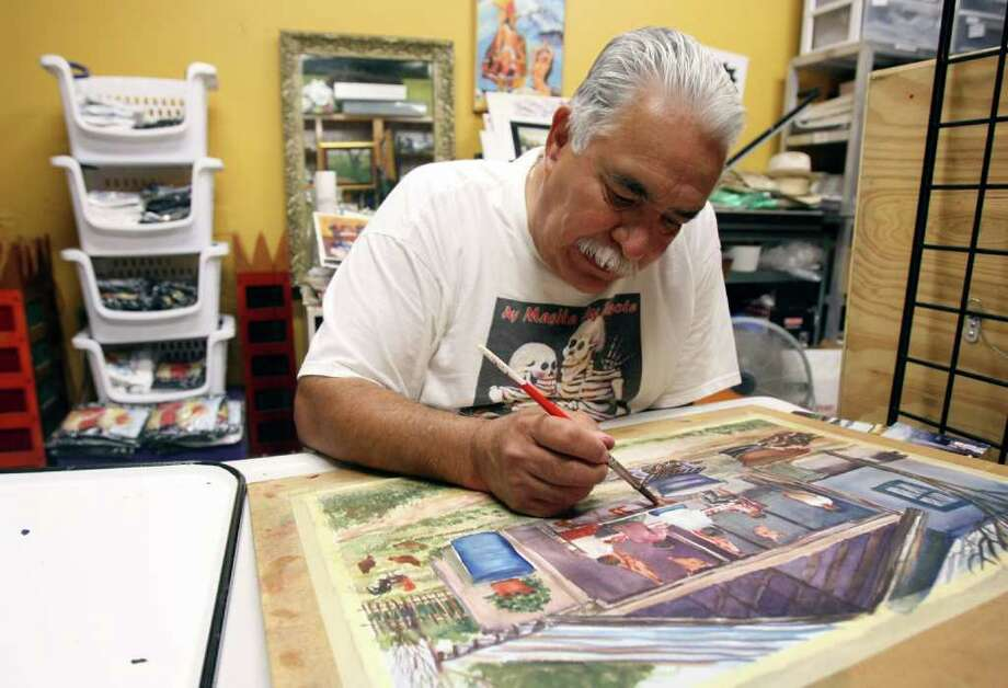 CONEXION:  Joe Lopez works on a painting at Gallista Gallery.  Lopez, started Gallista with his wife in 1998.  HELEN L. MONTOYA/hmontoya@express-new.net Photo: HELEN L. MONTOYA, San Antonio Express-News / SAN ANTONIO EXPRESS-NEWS