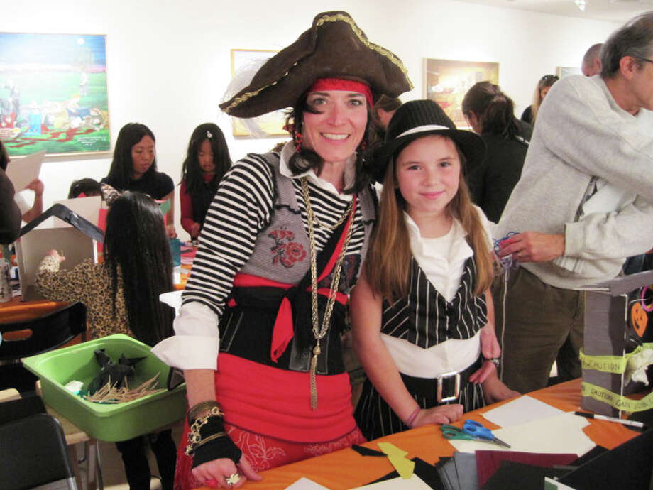 Wesport Arts Center Board Member Deirdre Price of Westport and her daughter, Gemma, 10, pose dressed as pirates during last year's WACky Family Day Costume Party. Photo: Contributed Photo/Alyssa Crouse