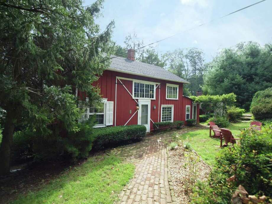 This converted barn at 211 Wilton Road offers lots of potential with a flexible floorplan covering almost 1,700 square feet. The nearly half-acre parcel includes flower beds and perennial plantings such as hydrangea, azalea, fern, hosta, rhododendron and English ivy. Photo: Contributed Photo