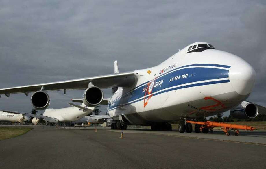 An Antonov AN-124 freighter is parked at Paine Field, in Everett, Wash., before the first Boeing 747-8 Freighter delivery on Oct. 12, 2011. Photo: Aubrey Cohen
