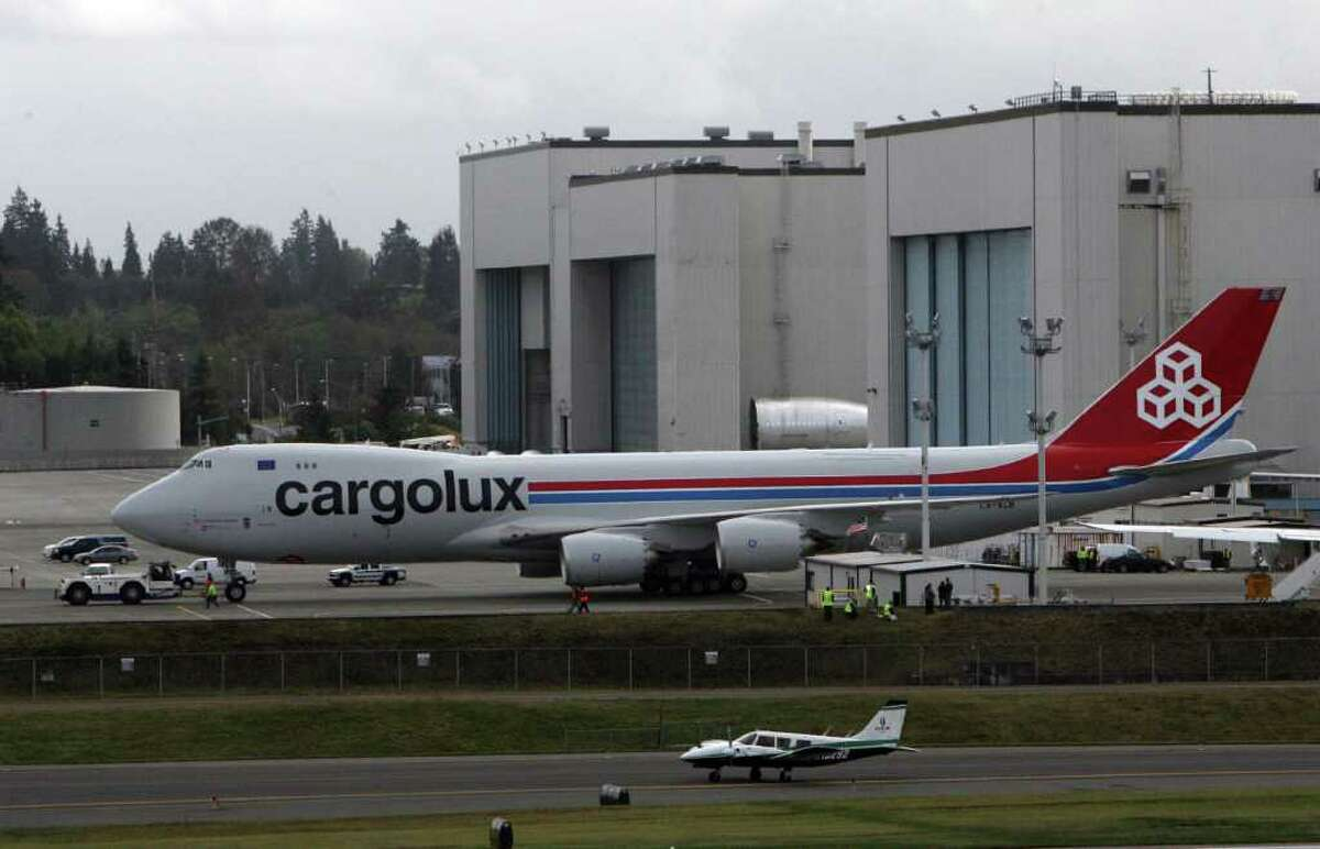 Cargolux's first 747-8 Freighter is towed away from Boeing's flight line beside Paine Field on Oct. 12, 2011 in Everett, Wash.