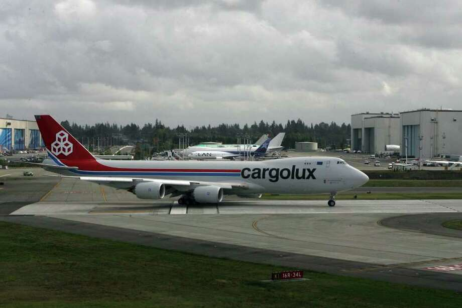 Cargolux's first 747-8 Freighter taxis onto the runway at Paine Field on Oct. 12, 2011 in Everett, Wash. Photo: Aubrey Cohen