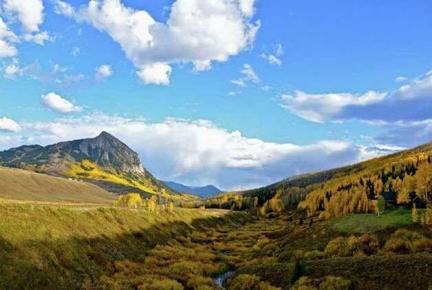 In the fall the base of Mt. Crested Butte, the craggy peak that overlooks the town, turns bright gold as the Aspens change color. Pete Holley photo