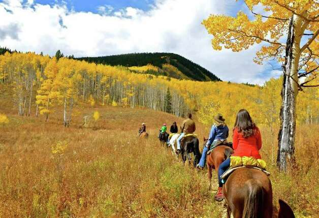 A horseback ride in the hills surrounding Crested Butte is one of the best ways to see the changing Aspens up close.  Pete Holley photo