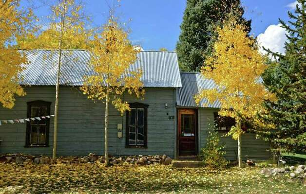 Ordinary homes, like this one just outside downtown, get a fall makeover as the weather changes in Crested Butte.  Pete Holley photo