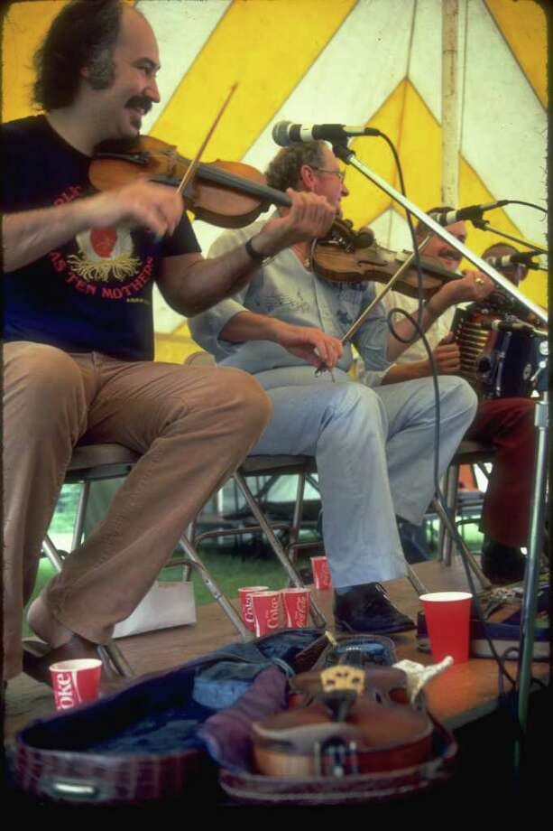 SOUNDS OF CAJUN COUNTRY: A Cajun band entertains at Festival Acadiens in Lafayette, La. Photo: Office Of Tourism