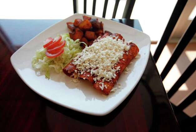 Enchiladas norte from Vida Mia Photo: Kin Man Hui, SAN ANTONIO EXPRESS-NEWS / San Antonio Express-News