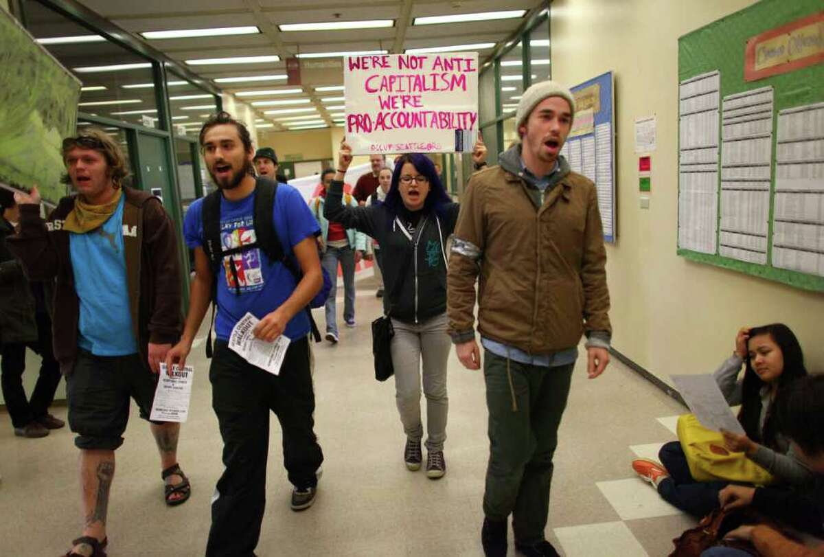 Students at Seattle Central Community College march through the school's hallways as students from area high schools and colleges walked out of classes and joined protesters at the Occupy Seattle protest at Westlake Park.