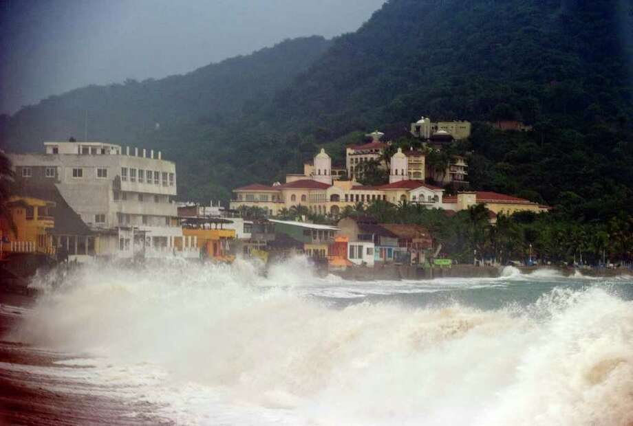 View of the seafront at the Barra de Navidad community, Jalisco State, Mexico on October 11, 2011.  Mexico's bustling port city of Manzanillo was bracing Tuesday for the arrival of Hurricane Jova, a powerful storm that forecasters said could unleash torrential rains and life-threatening mudslides. Photo: ALFREDO ESTRELLA, Getty / AFP