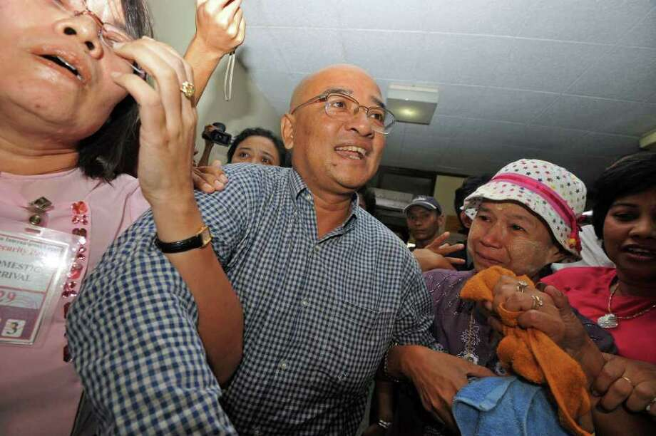 Prominent Myanmar comedian and vocal government critic, Zarganar (C), is welcomed by supporters upon his arrival at Yangon airport following his release from detention on October 12, 2011. Photo: SOE THAN WIN, Getty / AFP