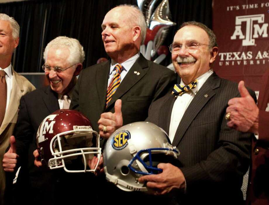 Southeastern Conference commissioner Mike Silve, left, the University of Florida president Bernie Machen, center, and Texas A&M president R. Bowen Loftin pose for a picture as Texas A&M officially enters the SEC, Monday, Sept. 26, 2011, in Kyle Field in College Station. ( Nick de la Torre / Houston Chronicle ) Photo: Nick De La Torre / © 2011 Houston Chronicle