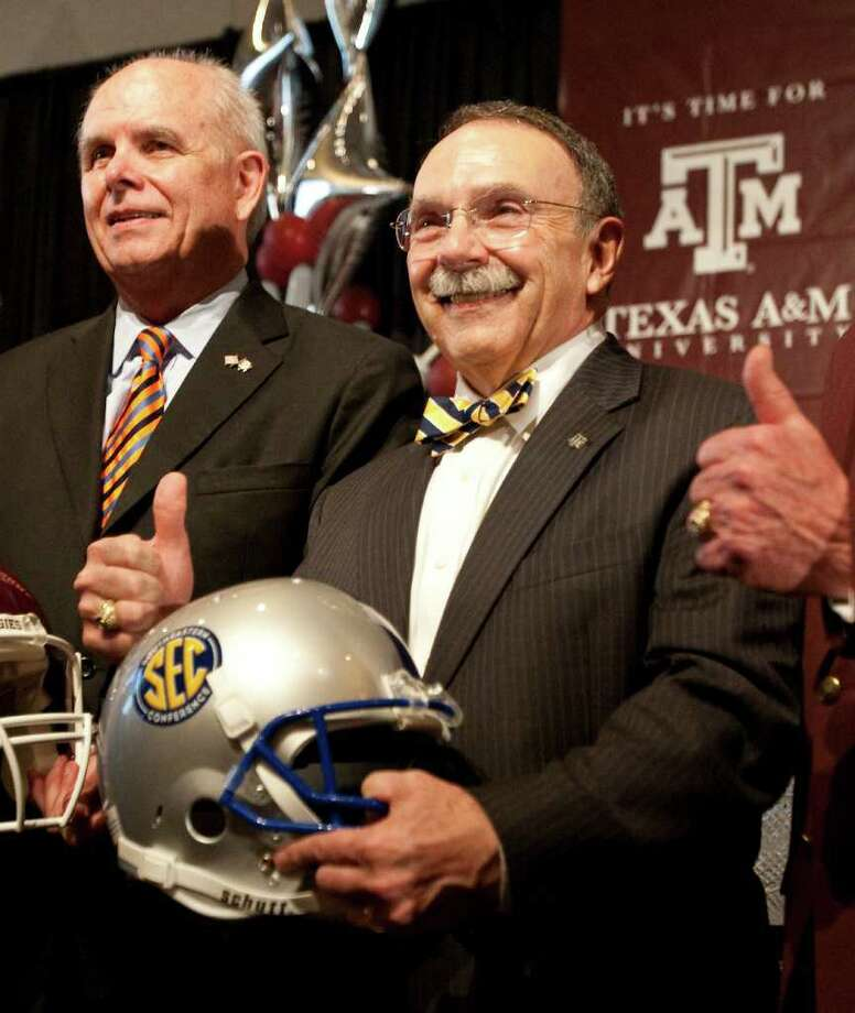 Texas A&M president R. Bowen Loftin, center, said through a spokesman that the situation is being handled as a personnel matter. Photo: Nick De La Torre / © 2011 Houston Chronicle