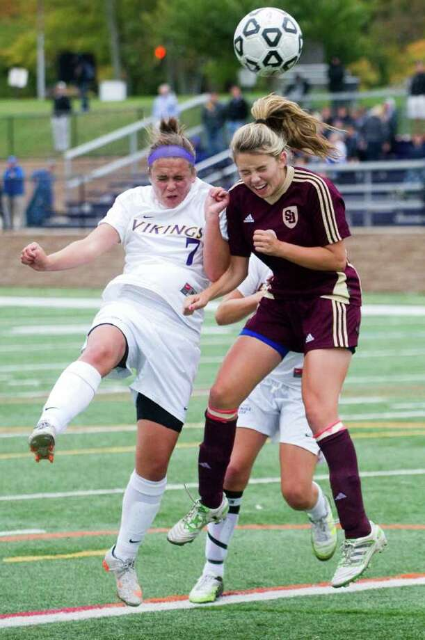 Westhill's C.C. Bingham fights St. Joseph's Sabrina Toole as Westhill High School hosts St. Joseph in a girls soccer game in Stamford, Conn., October 12, 2011. Photo: Keelin Daly / Stamford Advocate