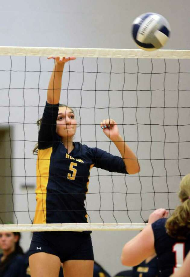 Weston's Savannah Carpenter (5) defends the net during the girls volleyball game against New Fairfield at Weston High School on Wednesday, Oct. 12, 2011. Photo: Amy Mortensen / Connecticut Post Freelance