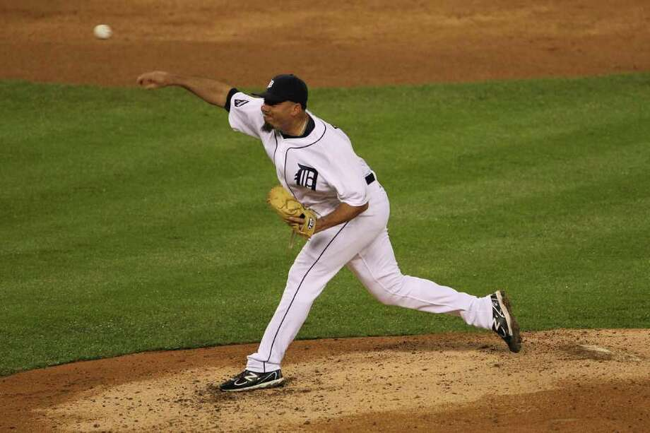 DETROIT, MI - OCTOBER 12:  Joaquin Benoit #53 of the Detroit Tigers throws a pitch against the Texas Rangers in Game Four of the American League Championship Series at Comerica Park on October 12, 2011 in Detroit, Michigan. Photo: Leon Halip, Getty / 2011 Getty Images