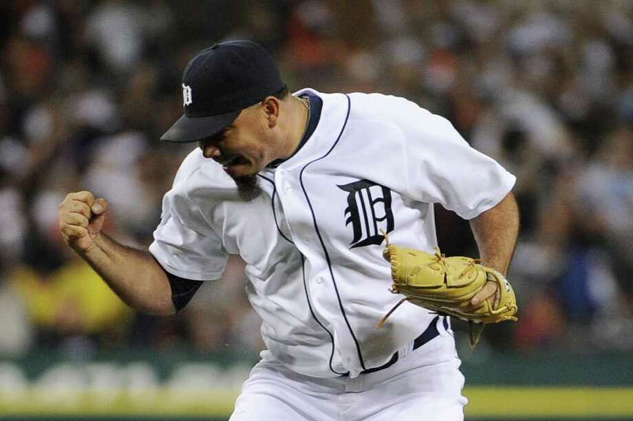 DETROIT, MI - OCTOBER 12:  Joaquin Benoit #53 of the Detroit Tigers celebrates a strike out of Adrian Beltre #29 of the Texas Rangers in the eighth inning of Game Four of the American League Championship Series at Comerica Park on October 12, 2011 in Detroit, Michigan. Photo: Harry How, Getty / 2011 Getty Images