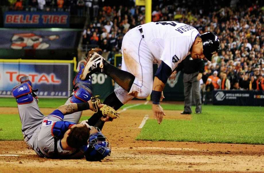 DETROIT, MI - OCTOBER 12:  Mike Napoli #25 of the Texas Rangers tags out Miguel Cabrera #24 of the Detroit Tigers at home plate for the final out of the eighth inning of Game Four of the American League Championship Series at Comerica Park on October 12, 2011 in Detroit, Michigan. Photo: Kevork Djansezian, Getty / 2011 Getty Images