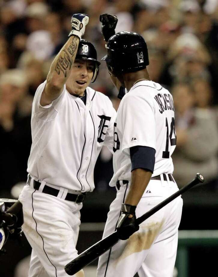 Detroit Tigers'  Brandon Inge greets teammate Austin Jackson after his home run in the seventh inning in Game 4 of baseball's American League championship series against the Texas Rangers, Wednesday, Oct. 12, 2011, in Detroit. (AP Photo/Paul Sancya) Photo: Paul Sancya, Associated Press / AP