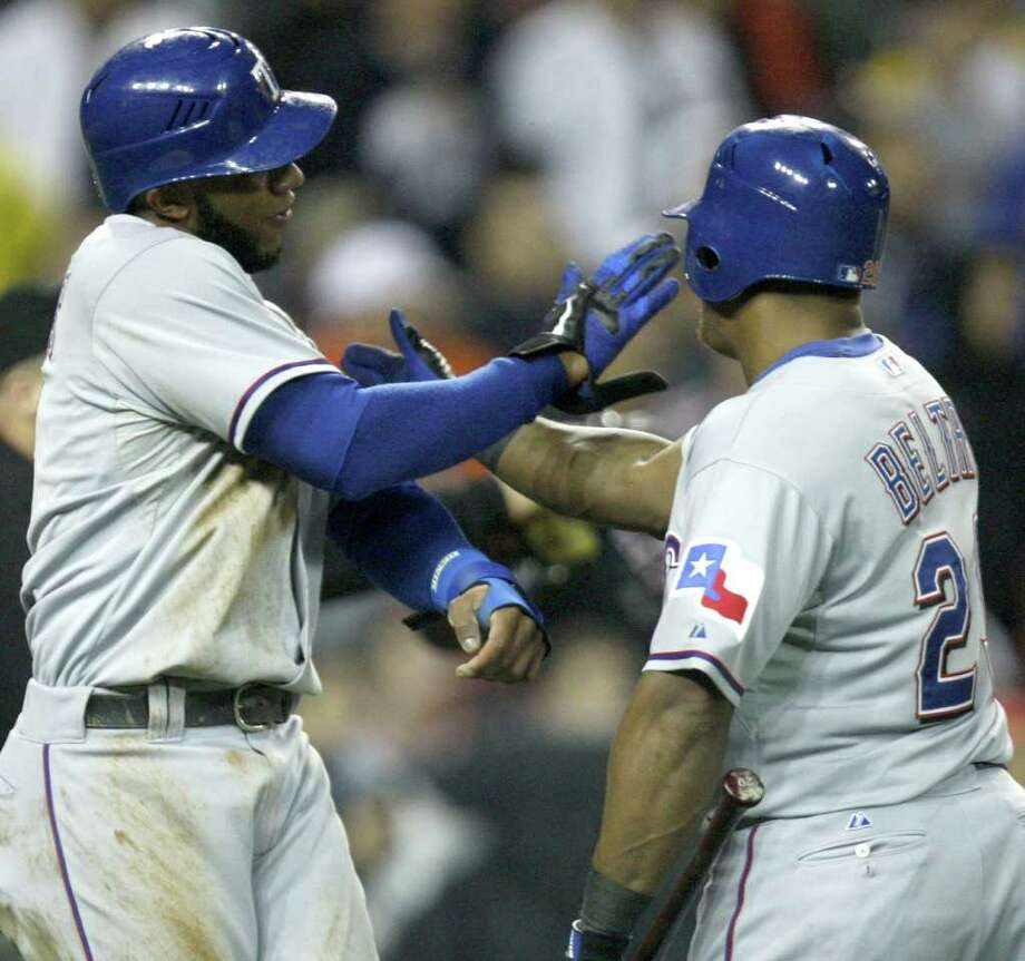 Texas Rangers Elvis Andrus celebrates with Adrian Beltre after scoring against the Detroit Tigers during sixth-inning action in Game 4 of the American League Championship Series at Comerica Park in Detroit, Michigan, Wednesday, October 12, 2011. (Kirthmon F. Dozier/Detroit Free Press/MCT) Photo: KIRTHMON  F. DOZIER, McClatchy-Tribune News Service / Detroit Free Press