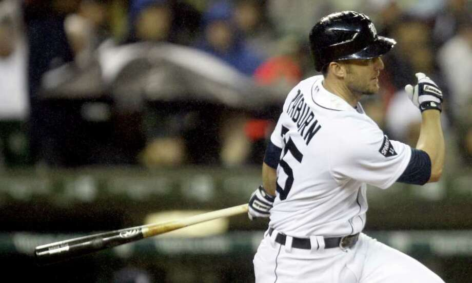 Detroit Tigers Ryan Raburn hits a single against the Texas Rangers during third-inning action in Game 4 of the American League Championship Series at Comerica Park in Detroit, Michigan, Wednesday, October 12, 2011. (Kirthmon F. Dozier/Detroit Free Press/MCT) Photo: KIRTHMON  F. DOZIER, McClatchy-Tribune News Service / Detroit Free Press