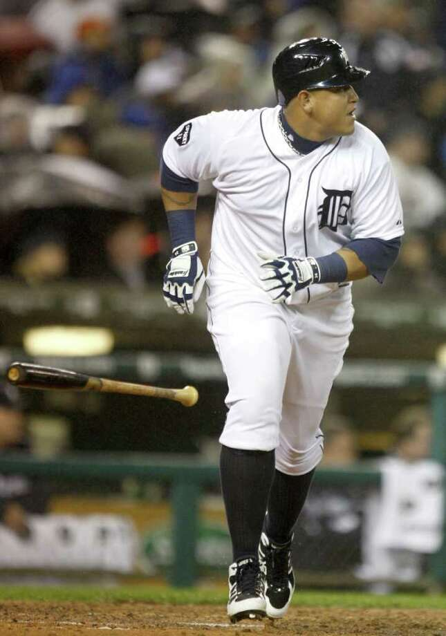 Detroit Tigers Miguel Cabrera drops his bat after hitting a 2-RBI double against the Texas Rangers during third-inning action in Game 4 of the American League Championship Series at Comerica Park in Detroit, Michigan, Wednesday, October 12, 2011. (Kirthmon F. Dozier/Detroit Free Press/MCT) Photo: KIRTHMON  F. DOZIER, McClatchy-Tribune News Service / Detroit Free Press