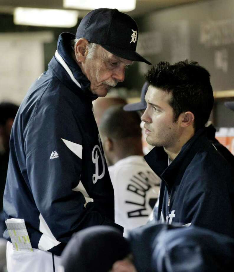 Detroit Tigers manager Jim Leyland talks to starting pitcher Rick Porcello after a pitching change in the seventh inning of Game 4 of baseball's American League championship series against the Texas Rangers, Wednesday, Oct. 12, 2011, in Detroit. (AP Photo/Paul Sancya) Photo: Paul Sancya, Associated Press / AP