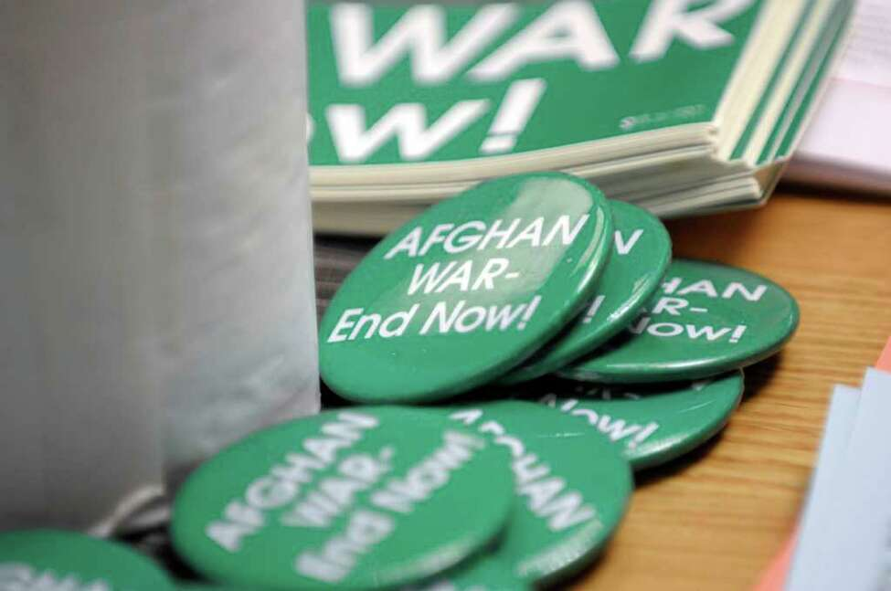 Buttons are seen on a table during a press event held by the organization Women Against War in the Legislative Office Building on Wednesday, Oct. 12, 2011 in Albany. The press event was held to announce the locations for a travel exhibit entitled