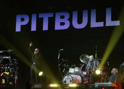 Bitbull performs as one of the opening acts for Enrique Iglesias's Euphoria Tour, Wednesday, Oct. 12, 2011, in Toyota Center in Houston. Photo: Nick De La Torre, Houston Chronicle / © 2011  Houston Chronicle