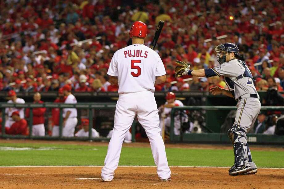 ST LOUIS, MO - OCTOBER 12:  Albert Pujols #5 of the St. Louis Cardinals is intentiaonally walked in the bottom of the fourth inning against the Milwaukee Brewers during Game Three of the National League Championship Series at Busch Stadium on October 12, 2011 in St Louis, Missouri. Photo: Dilip Vishwanat, Getty / 2011 Getty Images