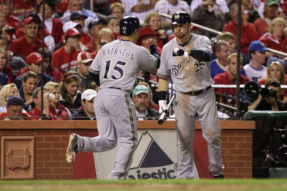 ST LOUIS, MO - OCTOBER 12:  (L-R) Jerry Hairston Jr. #15 and Mark Kotsay #25 of the Milwaukee Brewers celebrate after Hairston scored in the top of the secon dinning against the St. Louis Cardinals during Game Three of the National League Championship Series at Busch Stadium on October 12, 2011 in St Louis, Missouri. Photo: Christian Petersen, Getty / 2011 Getty Images