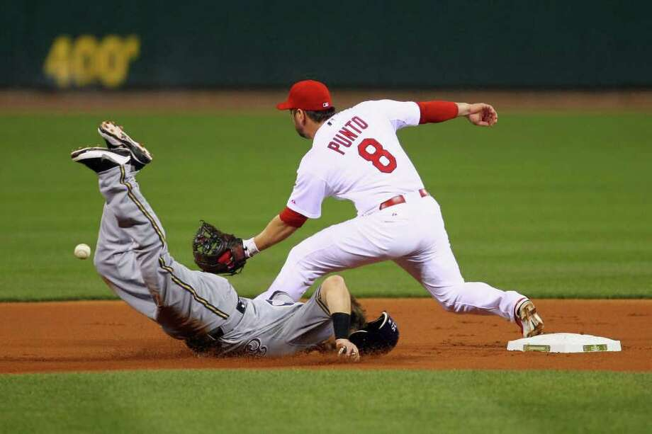 ST LOUIS, MO - OCTOBER 12:  Mark Kotsay #25 of the Milwaukee Brewers face plants on the infield dirt as he is forced out on a double play in the top of the first inning against Nick Punto #8 of the St. Louis Cardinals during Game Three of the National League Championship Series at Busch Stadium on October 12, 2011 in St Louis, Missouri. Photo: Dilip Vishwanat, Getty / 2011 Getty Images