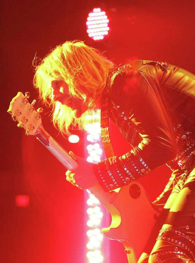 Judas Priest guitarist Richie Faulkner plays to the crowd during the heavy metal band's concert at the AT&T Center on Wednesday, Oct. 12, 2011. Kin Man Hui/kmhui@express-news.net Photo: --