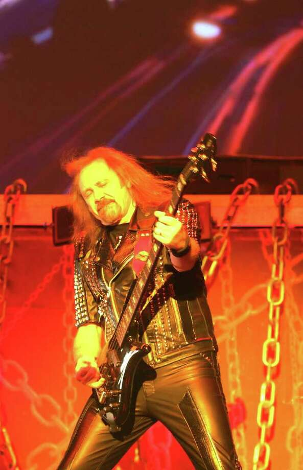 Judas Priest bassist Ian Hill performs during the heavy metal band's concert at the AT&T Center on Wednesday, Oct. 12, 2011. Kin Man Hui/kmhui@express-news.net Photo: --