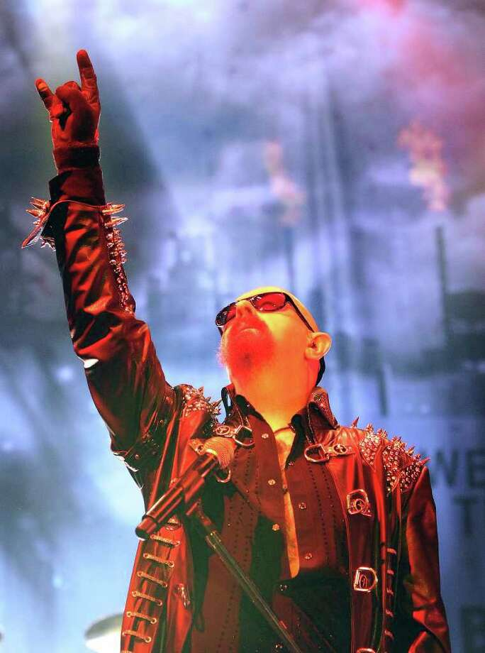 Judas Priest lead singer Rob Halford gestures the heavy metal sign during the band's concert at the AT&T Center on Wednesday, Oct. 12, 2011. Kin Man Hui/kmhui@express-news.net Photo: --