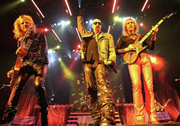 Members of Judas Priest Richie Faulkner (from left), Rob Halford and Glenn Tipton take front and center stage during the heavy metal band's concert at the AT&T Center on Wednesday, Oct. 12, 2011. Kin Man Hui/kmhui@express-news.net Photo: --