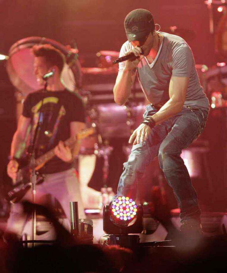 Enrique Iglesias performs for his Euphoria Tour, Wednesday, Oct. 12, 2011, in Toyota Center in Houston. Photo: Nick De La Torre, Houston Chronicle / © 2011  Houston Chronicle