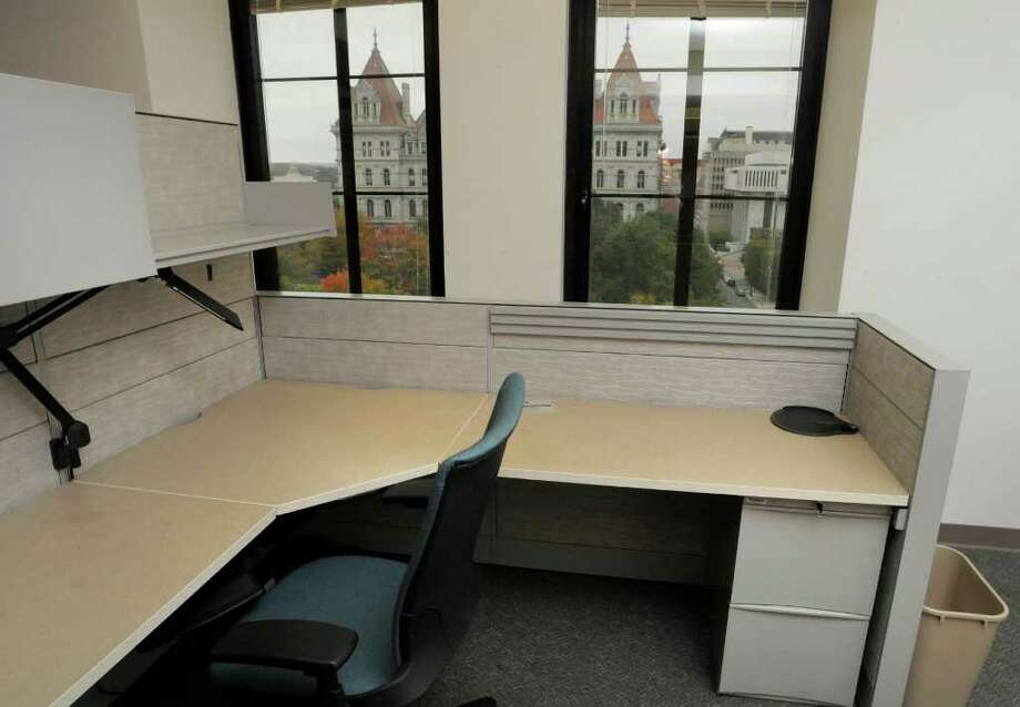 A view of an empty wing of the sixth floor of the Alfred E. Smith building on Wednesday, Oct. 12, 2011 in Albany.  This wing of the building once housed the offices of civil service.  Through the window the Capitol building is visible.  (Paul Buckowski / Times Union) Photo: Paul Buckowski