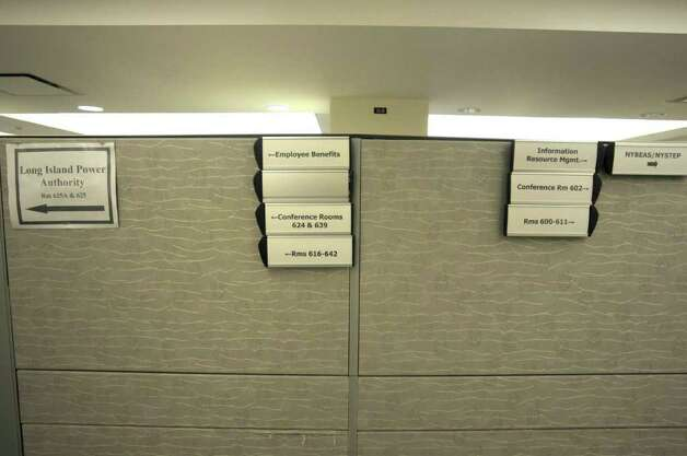 Signs pointing people to different departments are seen on a partition wall on the sixth floor of the Alfred E. Smith building on Wednesday, Oct. 12, 2011 in Albany.  This section of the sixth floor is occupied.  (Paul Buckowski / Times Union) Photo: Paul Buckowski