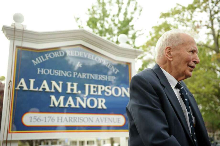 Alan H. Jepson stands in front of the sign bearing his name during a dedication ceremony Wednesday, Oct. 12, 2011 renaming the Walnut Beach public housing complex the Alan H. Jepson Manor Public Housing Development. Photo: Autumn Driscoll