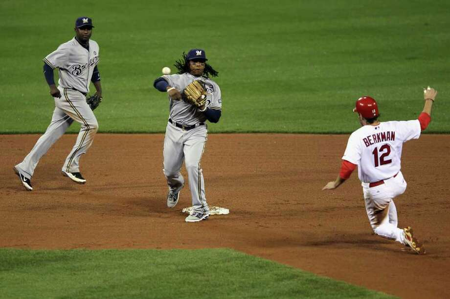 ST LOUIS, MO - OCTOBER 12:  Rickie Weeks #23 of the Milwaukee Brewers turns a successful double play over a sliding Lance Berkman #12 of the St. Louis Cardinals on a ball hit by David Freese #23 in the bottom of the seventh inning during Game Three of the National League Championship Series at Busch Stadium on October 12, 2011 in St Louis, Missouri. Photo: Jamie Squire, Getty / 2011 Getty Images